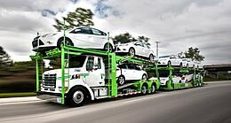 Truck loaded with cars
